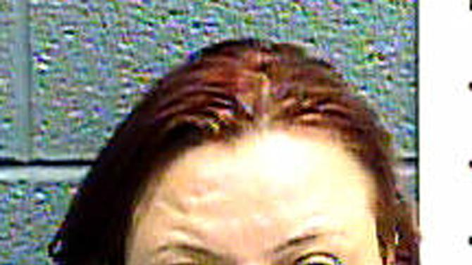 This image provided Jan. 25, 2013 by the Las Cruces Police Department, shows Cindy Patriarchias, 33, following her arrest for child abuse. Police say she and her boyfriend locked up an 8-year-old girl with developmental disabilities in a wooden cage, then left her alone while they headed out to watch a movie. (AP Photos/Las Cruces Police Department)