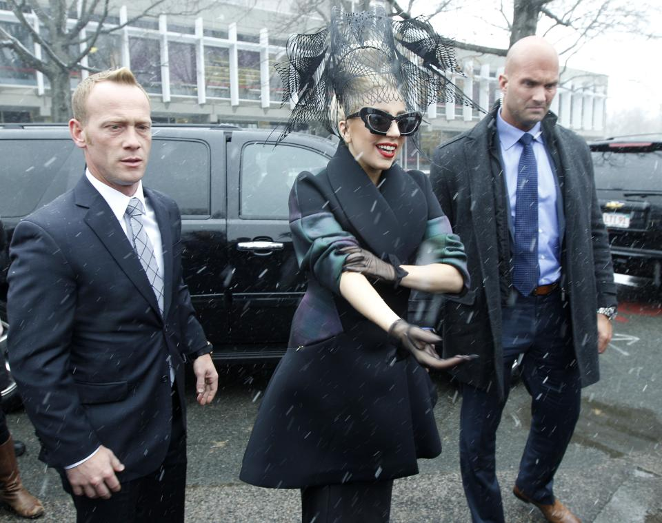 "Lady Gaga walks through the campus prior to an event at Harvard University in Cambridge, Mass. Wednesday Feb. 29, 2012. Gaga launched her ""Born this Way"" foundation at Harvard. (AP Photo/Charles Krupa)"