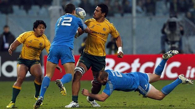 Australia's Sitaleki Timani (2nd R) is tackled by Italy's Leonardo Ghiraldini (R) and Alberto Sgarbi (2nd L) during their Test match at the Franchi stadium in Florence (Reuters)