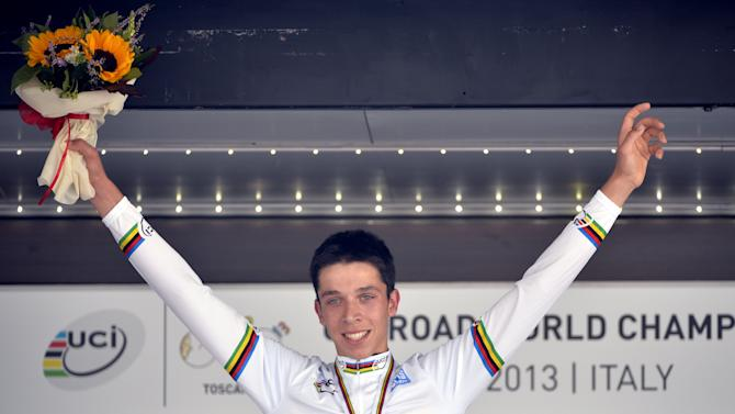 Belgian cycling star Igor Decraene on September 24, 2013 on the podium after winning the men's juniors time trial race at the World Cycling championships in Florence