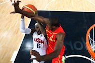 Serge Ibaka (R) of Spain defends against LeBron James (L) of the US during the London 2012 Olympic Games men&#39;s gold medal basketball game between USA and Spain at the North Greenwich Arena in London