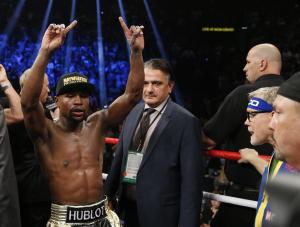 Floyd Mayweather Jr., left, celebrates after his welterweight …