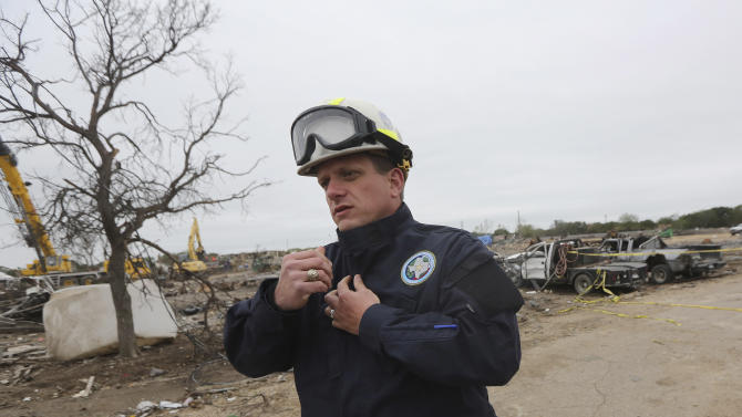 Assistant State Fire Marshal Kelly Kistner, walks by the destroyed fertilizer plant during a tour of the site in West, Texas, Thursday, May 2, 2013. Investigators face a slew of challenges in figuring out what caused the explosion at the fertilizer plant that killed 14 people and destroyed part of the small Texas town. (AP Photo/LM Otero, Pool)