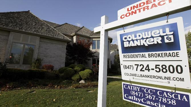 In this Wednesday, Oct. 10, 2012, photo, an under contract sign sits outside a home in Glen, Ill. A measure of U.S. home prices rose 6.3 percent in October compared with a year ago, the largest yearly gain since July 2006. The jump adds to signs of a comeback in the once-battered housing market.  (AP Photo/Nam Y. Huh)