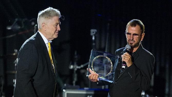 """Director David Lynch, left, presents musician Ringo Starr with the """"Lifetime of Peace & Love Award"""" on stage during the David Lynch Foundation Honors Ringo Star """"A Lifetime of Peace & Love"""" event held at the El Rey Theatre on Monday, Jan. 20, 2014, in Los Angeles. (Photo by Paul A. Hebert/Invision/AP)"""