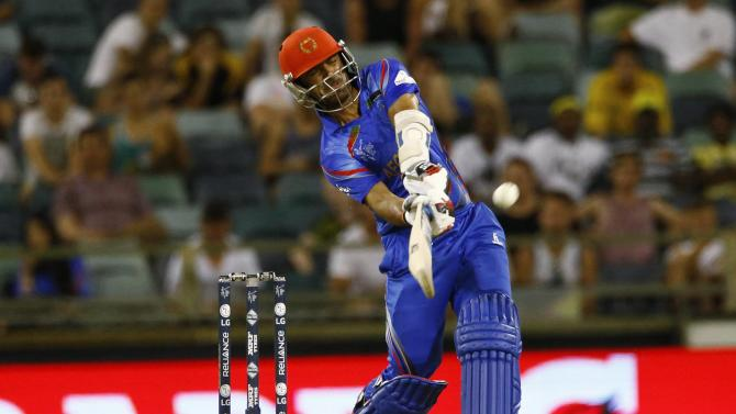 Afghanistan's batsman Nawroz Mangal hits the ball for six runs during his Cricket World Cup match against Australia in Perth