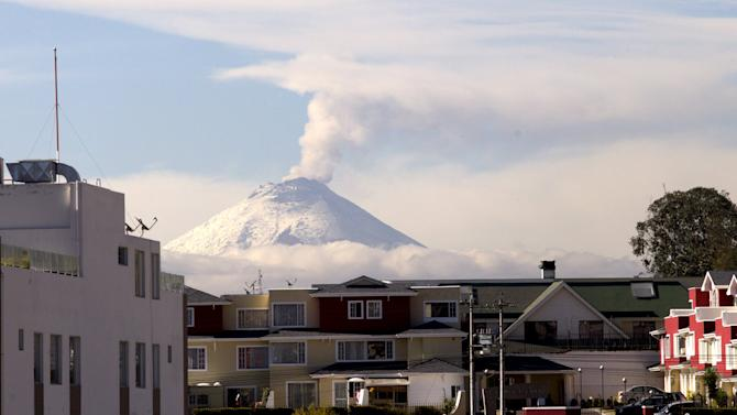 The Cotopaxi volcano, one of the world's highest active volcanoes, spews smoke as seen from Quito