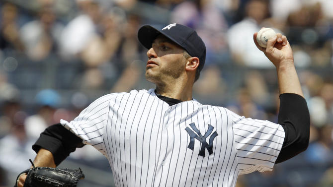 New York Yankees starting pitcher Andy Pettitte delivers in the first inning against the New York Mets during their baseball game at Yankee Stadium in New York, Sunday, June 10, 2012.  (AP Photo/Kathy Willens)