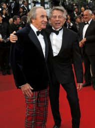 "Director Roman Polanski (R) and former Formula One champion driver Jackie Stewart of Britain pose on the red carpet as they arrive for the screening of the film ""All is Lost"" during the  the 66th Cannes Film Festival in Cannes May 22, 2013.            REUTERS/Regis Duvignau (FRANCE  - Tags: ENTERTAINMENT SPORT)"