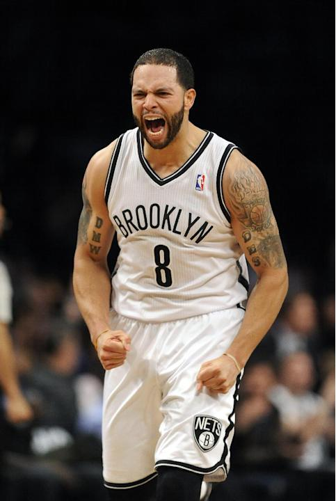 Brooklyn Nets' Deron Williams (8) celebrates his three pointer against the Toronto Raptors in the second half of an NBA basketball game on Monday, March 10, 2014 at Barclays Center in New York. Th