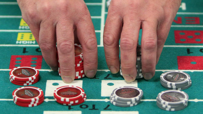 William Bertke practices stacking chips during a training session, Tuesday, Nov. 27, 2012, at Horseshoe Casino Cincinnati in Cincinnati. One of the safest bets at the new casino set to open this spring is that cheaters will be among the gamblers, targeting dealers who have only dealt cards in a training room. (AP Photo/Al Behrman)