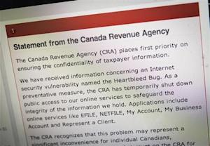 "The Canada Revenue Agency website is seen on a computer screen displaying information about an internet security vulnerability called the ""Heartbleed Bug"" in Toronto"