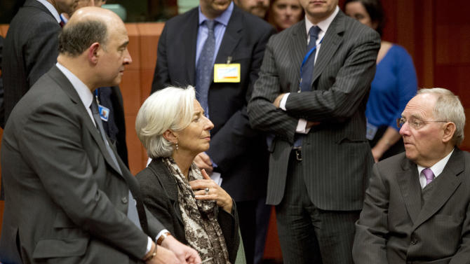 From left, French Finance Minister Pierre Moscovici, Managing Director of the International Monetary Fund Christine Lagarde and German Finance Minister Wolfgang Schaeuble speak with each other during an emergency eurogroup meeting in Brussels on Sunday, March 24, 2013. The EU says a top official will chair a high-level meeting on Cyprus in a last-ditch effort to seal a deal before finance ministers decide whether the island nation gets a 10 billion euro bailout loan to save it from bankruptcy. (AP Photo/Geert Vanden Wijngaert)