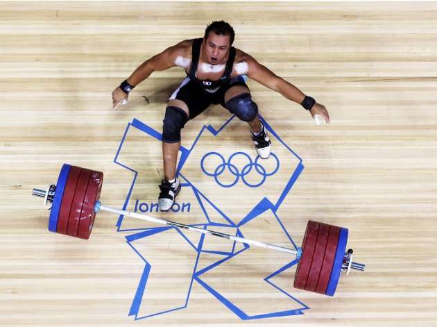 Egypt's Tarek Abdelazim lifts on the men's 85Kg group A weightlifting competition at the ExCel venue at the London 2012 Olympic Games