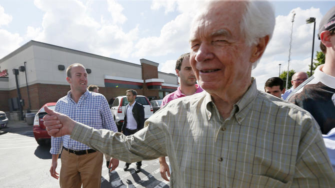 U.S. Sen. Thad Cochran, R-Miss., gives a thumbs up to supporters as he leaves a stop on the first day of a three-week campaign, Wednesday, June 4, 2014. Cochran, 76 and seeking a seventh term, faces state Sen. Chris McDaniel of Ellisville. (AP Photo/Rogelio V. Solis)