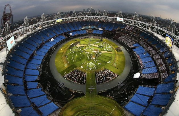 Actors perform during a pre-show in the Olympic Stadium before the opening ceremony of the London 2012 Olympic Games