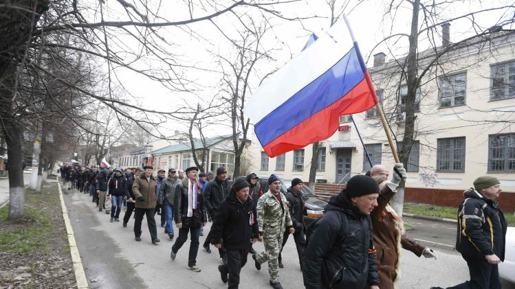 Pro-Russian supporters march with the Russian flag during a rally in Simferopol