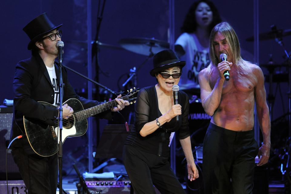 "Yoko Ono, center, performs with her son Sean Lennon, left, and special guest Iggy Pop during the ""Yoko Ono: We Are Plastic Ono Band"" concert at the Orpheum Theater in Los Angeles, Friday, Oct. 1, 2010. (AP Photo/Chris Pizzello)"