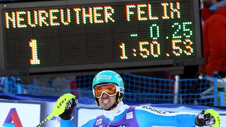 Germany's Felix Neureuther celebrates at the finish area after winning an Alpine ski World Cup men's slalom, in Wengen, Switzerland, Sunday, Jan. 20, 2013. (AP Photo/Alessandro Trovati)