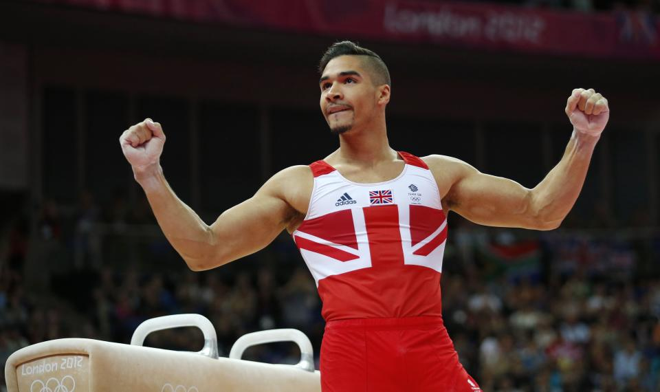 Great Britain's gymnast Louis Smith gestures after his performance on the pommel horse during the Artistic Gymnastic men's team final at the 2012 Summer Olympics, Monday, July 30, 2012, in London. (AP Photo/Matt Dunham)