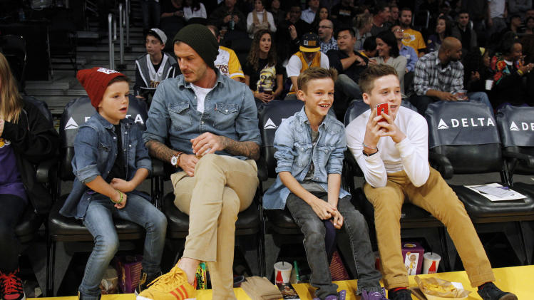 David Beckham sits with his sons Cruz, Romeo and Brooklyn before the NBA game between the Lakers and Suns in Los Angeles