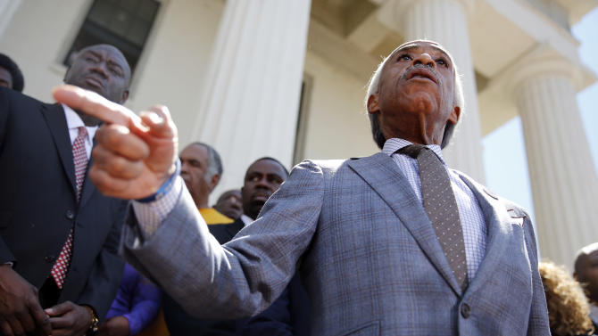 Civil rights leader Rev. Al Sharpton speaks during a news conference outside the Old Courthouse Tuesday, Aug. 12, 2014, in St. Louis. Racial tensions have run high in Ferguson, Mo., where crowds have looted and burned stores, vandalized vehicles and taunted police after following the shooting death of Michael Brown, 18, an unarmed black man by police. (AP Photo/Jeff Roberson)