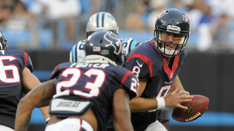 Houston Texans quarterback Matt Schaub (8) prepares to hand off to Arian Foster (23) during the first half of an NFL preseason football game against the Carolina Panthers in Charlotte, N.C., Saturday, Aug. 11, 2012. (AP Photo/Mike McCarn)