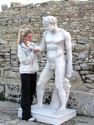 Monica works on her statue during the Roadblock challenge in Sicily CBS' The Amazing Race 9