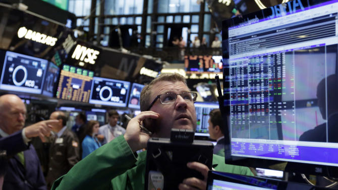 Trader Kevin Coulter works on the floor of the New York Stock Exchange Monday, July 8, 2013. Stocks rose in early trading Monday ahead of the start of second-quarter corporate earnings reports. (AP Photo/Richard Drew)