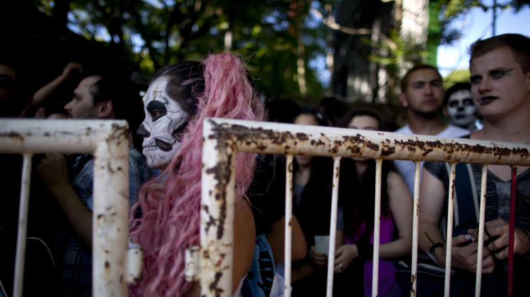"Lady Gaga fans stand outside, waiting to enter the stadium where the U.S. pop star will perform a concert, in Buenos Aires, Argentina, Friday, Nov. 16, 2012. The Latin American leg of her, ""Born This Way Ball Tour,"" is coming to an end but not before stopping in Chile, Peru and Paraguay. (AP Photo/Natacha Pisarenko)"