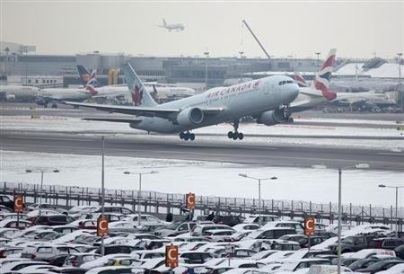 An Air Canada aircraft takes off after snowfall at Heathrow airport in London January 21, 2013. REUTERS/Neil Hall