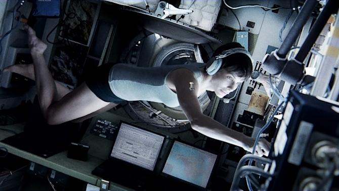 "This publicity photo released by courtesy of Warner Bros. Pictures shows Sandra Bullock, as Dr. Ryan Stone, in Warner Bros. Pictures' sci-fi thriller ""Gravity,"" a Warner Bros. Pictures release. (AP Photo/Courtesy Warner Bros. Pictures)"