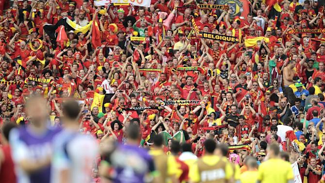 Belgium supporters celebrate in the stands after the group H World Cup soccer match between Belgium and Russia at the Maracana Stadium in Rio de Janeiro, Brazil, Sunday, June 22, 2014. Belgium won the match 1-0. (AP Photo/Ivan Sekretarev)