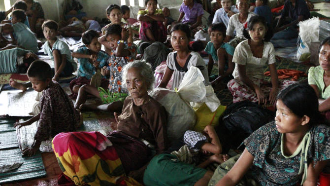 Local residents take refuge in a monastery compound in Sittwe, the capital of Rakhine state in western Myanmar, where sectarian violence continues to impact the public, Wednesday, June 13, 2012. Heavy rain Wednesday brought an uneasy calm to western Myanmar after five days of deadly sectarian strife, though residents said they were too afraid to sleep at night and faced food shortages. (AP Photo/Khin Maung Win)