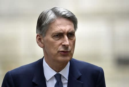 Britain's Foreign Secretary Philip Hammond arrives in Downing Street in central London
