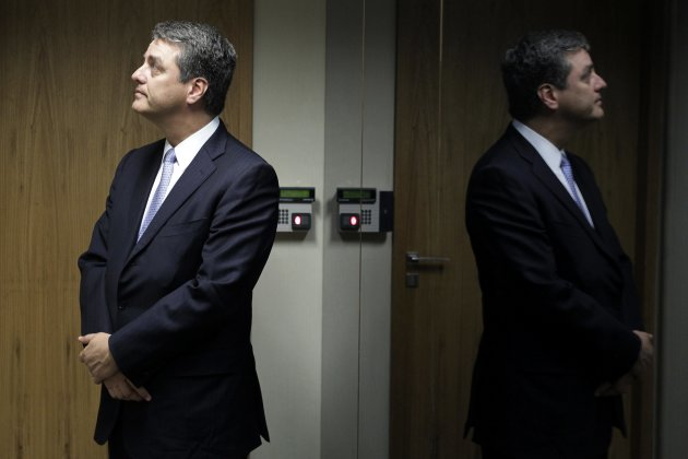 Azevedo, incoming head of WTO, waits for an elevator after a meeting with Brazil's Finance Minister Guido Mantega in Brasilia
