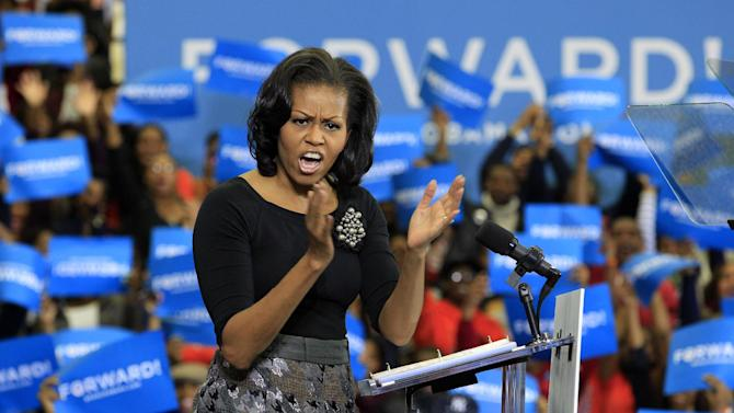 First lady Michelle Obama gestures during a campaign rally for her husband, President Barack Obama, Friday, Nov. 2, 2102, at Virginia State University in  Petersburg, Va.  (AP Photo/Steve Helber)