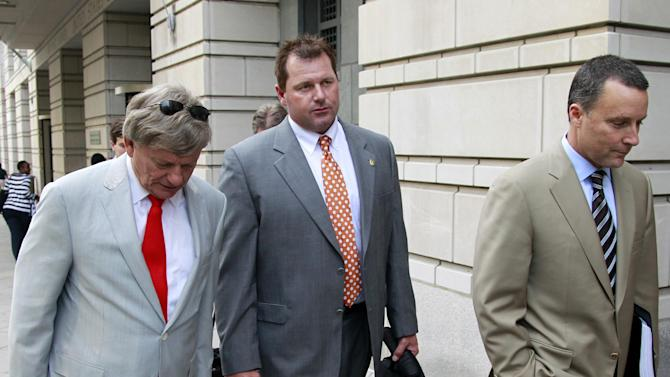 Former Major League Baseball pitcher Roger Clemens, center, and his lawyers Rusty Hardin, left, and Michael Attanasio leave a federal court house, Wednesday, May 2, 2012, in Washington, as his retrial continues on charges of lying to Congress in 2008 when he said he had never used steroids of human growth hormone. . (AP Photo/Haraz N. Ghanbari)