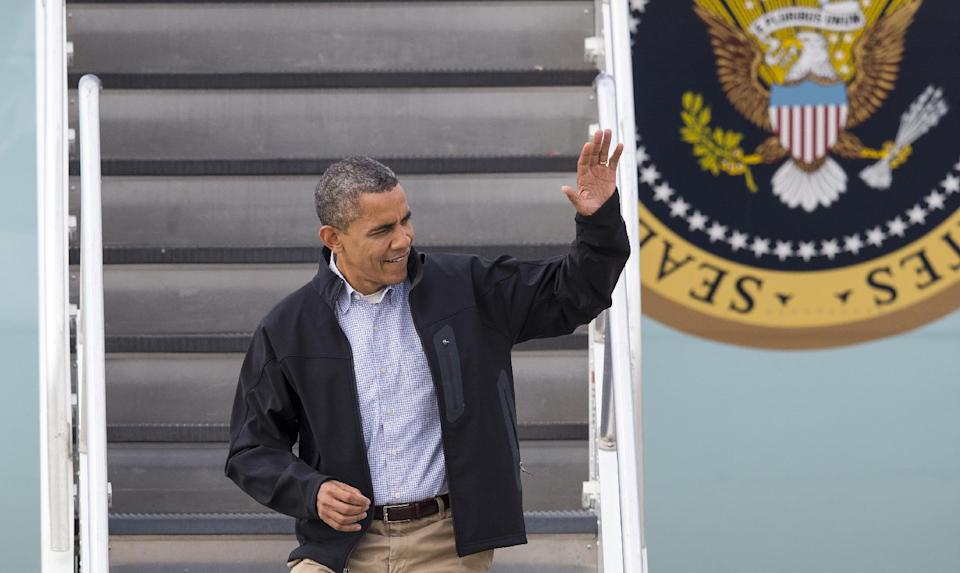 President Barack Obama waves from Air Force One as he arrives in Madison, Wis., Thursday, Oct. 4, 2012. (AP Photo/Tom Lynn)