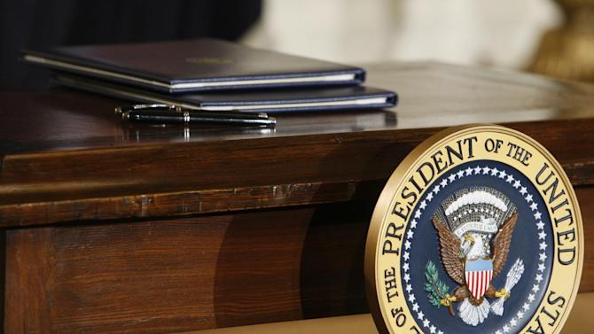 FILE – In this Jan. 26, 2009, file photo executive orders await the signature of President Barack Obama, not pictured, as he speaks about jobs, energy independence and climate change in the East Room of the White House in Washington. Absent a magic potion or explosive economic growth, it was all but inevitable President Barack Obama would have to break some of his campaign promises to keep others, distinguished as they were by their incompatibility. Every president since Richard Nixon has pushed to cut U.S. dependence on imported oil, but now, for the first time in 30 years, oil imports are falling in a significant way. But even if the U.S. is successful at further reducing imports, prices at the pump will not go down, because oil and gas are global commodities. (AP Photo/Charles Dharapak)