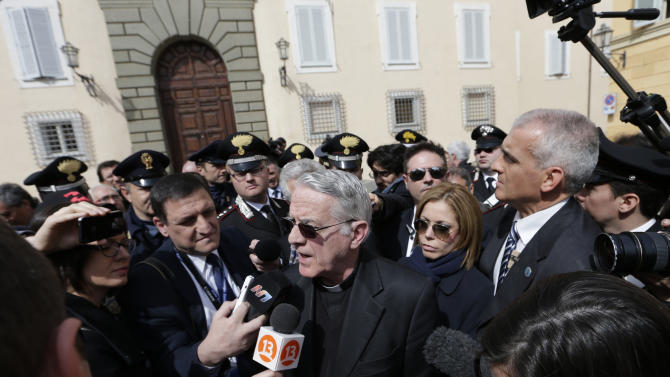 """Vatican spokesman Rev. Federico Lombardi meets journalists outside the papal residence in Castel Gandolfo, Saturday March 23, 2013. Pope Francis traveled Saturday to this hilltown south of Rome to have lunch with his """"brother"""" and predecessor Benedict XVI, an historic and potentially problematic melding of the papacies that has never before confronted the Catholic Church. The two men in white embraced warmly on the helipad in the gardens of Castel Gandolfo, where Benedict has been living since he retired Feb. 28 and became the first pope to resign in 600 years. (AP Photo/Alessandra Tarantino)"""