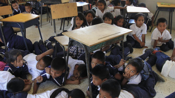 Students participate in an evacuation drill, in the event that they are caught in a crossfire between army and Revolutionary Armed Forces of Colombia (FARC) rebels, at a school in Toribio