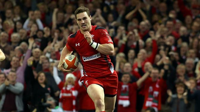 Wales wing George North runs in to score a try during the Six Nations international rugby union match between Wales and Scotland at the Millennium Stadium in Cardiff, south Wales, on March 15, 2014