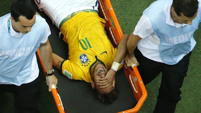 Brazil's forward Neymar suffers an injury during their match against Colombia in Brazil on July 4, 2014