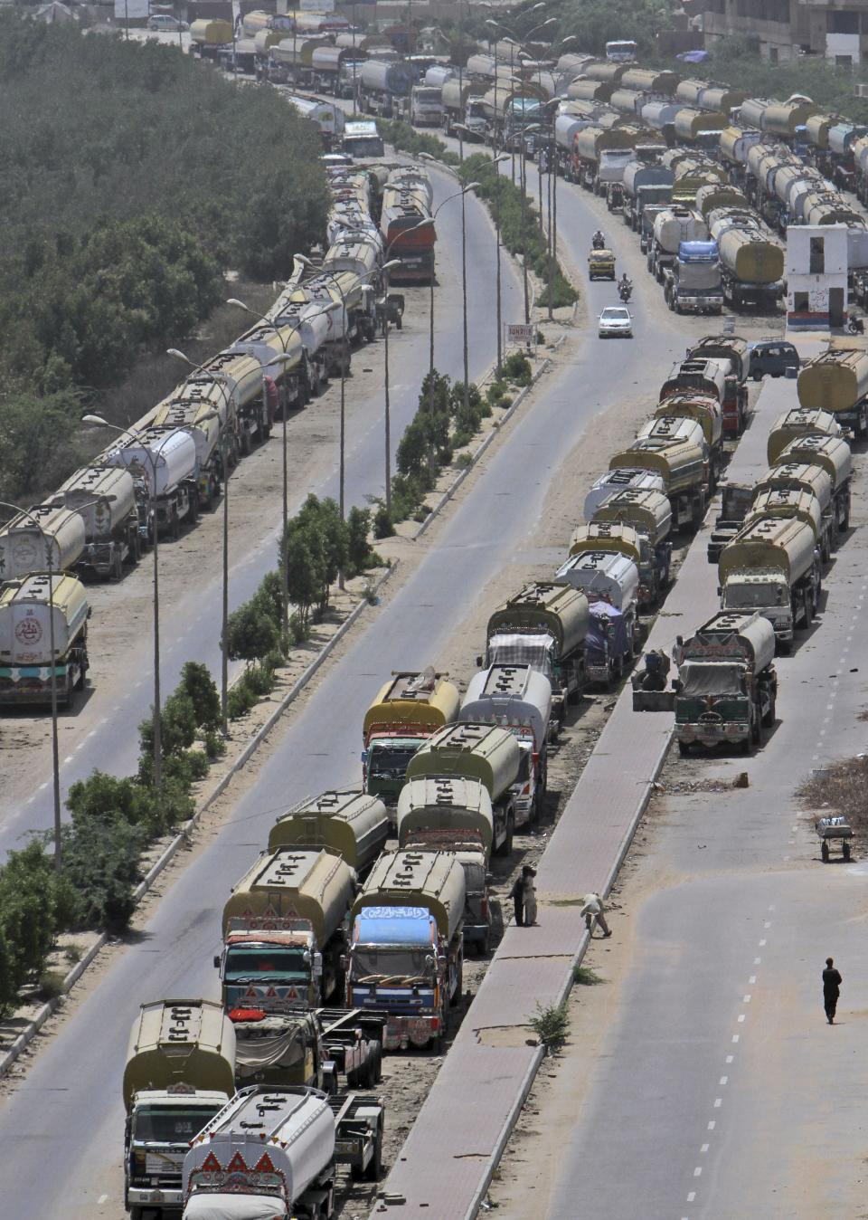Oil tankers, which were used to transport NATO fuel supplies to Afghanistan, are parked in Karachi, Pakistan, Wednesday, May 23, 2012. (AP Photo/Fareed Khan)