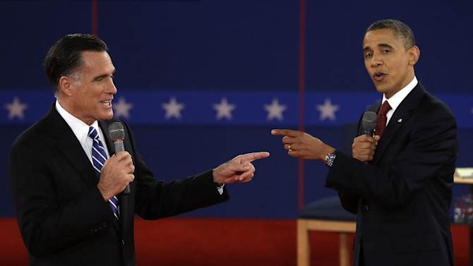 FOR USE AS DESIRED, YEAR END PHOTOS - FILE - In this Oct. 16, 2012 file photo, Republican presidential nominee Mitt Romney, left, and President Barack Obama spar during the second presidential debate at Hofstra University in Hempstead, N.Y. (AP Photo/Charlie Neibergall, File)