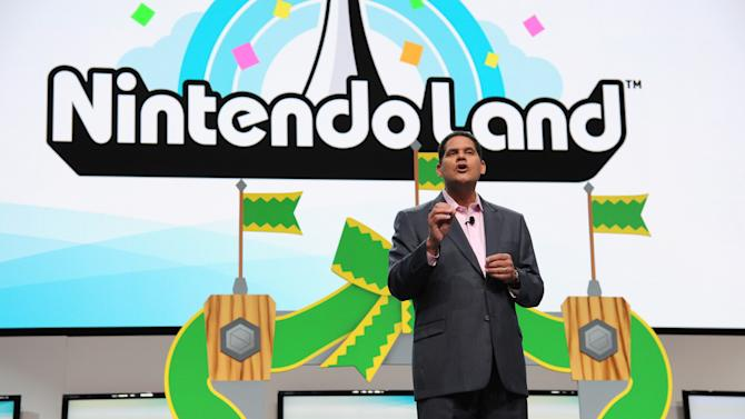 "FILE - This June 5, 2012 publicity photo provided by Nintendo shows Reggie Fils-Aime, Nintendo of America's President and Chief Operating Officer, speaking onstage at the Nintendo All-Access Presentation @ E3, in Los Angeles. The loveable green-skinned critter Yoshi and princess-rescuing adventurer Link and are coming the Nintendo 3DS. The Japanese gaming giant announced plans Wednesday, April 17, 2013, to bring ""Yoshi's Island,"" ""The Legend of Zelda"" and ""Mario Party"" games to its handheld gaming system. (AP Photo/Nintendo, Vince Bucci)"
