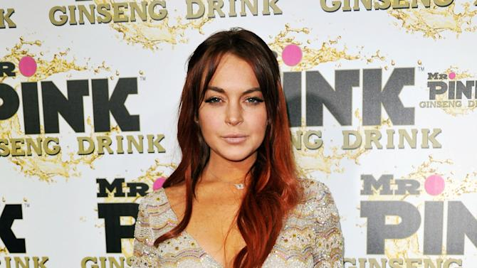 FILE - In this Oct. 11, 2012 file photo, Lindsay Lohan attends the Mr. Pink Ginseng launch party at the Beverly Wilshire hotel in Beverly Hills, Calif. An attorney for Lindsay Lohan says New York City prosecutors will not charge her for an alleged fight at a Manhattan nightclub last November. Attorney Marc Heller says the actress faces no formal charges after prosecutors were unable to gather sufficient evidence to prove the case. Lohan was arrested Nov. 29 on a charge of misdemeanor assault after an incident with Tiffany Mitchell at the club Avenue in the city's trendy Meat Packing district. (Photo by Richard Shotwell/Invision/AP, File)