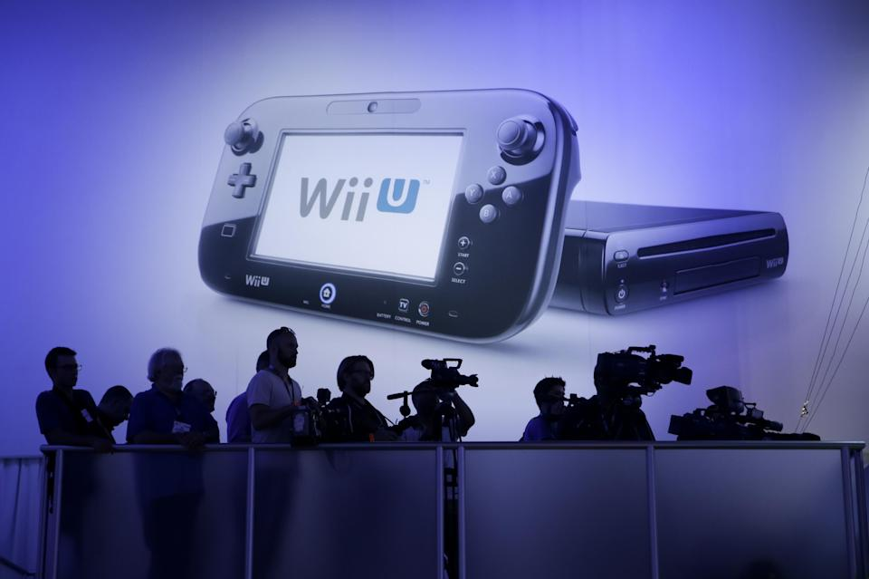 Members of the media watch a presentation from a riser at the Nintendo Wii U software showcase during the E3 game show in Los Angeles, Tuesday, June 11, 2013. (AP Photo/Jae C. Hong)