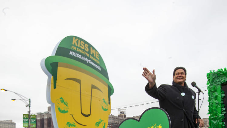 "IMAGE DISTRIBUTED FOR GILLETTE -Football Hall of Fame star Dan ""Danimal"" Hampton declares ""Kiss Me, I'm Smooth Shaven!"" on board the Gillette float during the St. Patrick's Day Parade in Chicago, on Saturday, March 16, 2013. (Photo by Barry Brecheisen/Invision for Gillette/AP Images)"